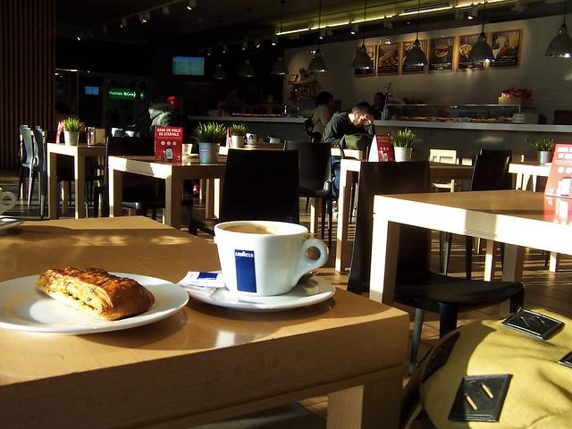 Coffee, pastry and rucksack - Girona railway station buffet