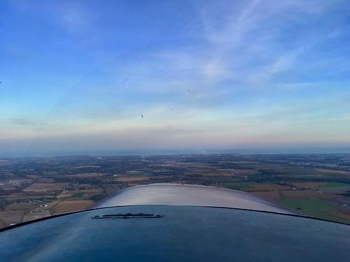 flight generalaviation flying universityofmichiganflyers cessna 152 michigan sunset clouds