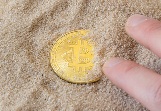Bitcon in sand | by wuestenigel