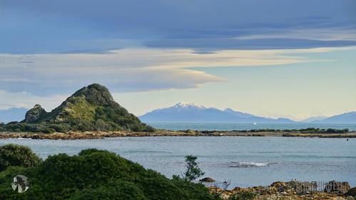 blue sky sun mountain green water clouds island sony a58 taputeranga aravenimage q32015 tiomraven