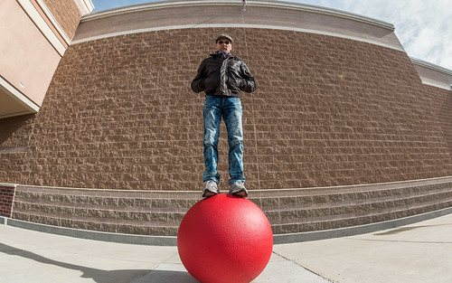 Standing on a Red Concrete Ball at Target