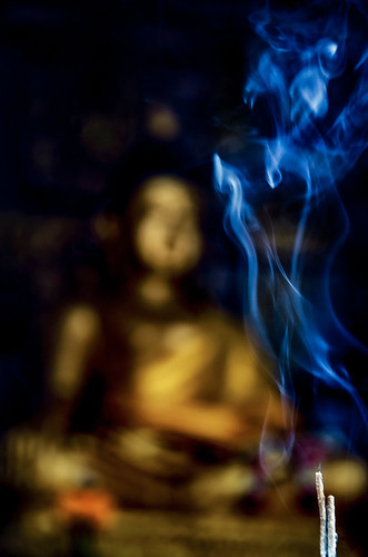 smoke plumes incense sticks smoking buddha watdoikukham วัดดอยกู่คำ temple chiangmaiprovince hangdong northernthailand asia thai siam reverence faith belief religion spirituality culture tradition statue art icon deity divine divinity worship fire flame mystery dof bokeh blue gold golden scent fragrance aromatic meditation prayer aroma buddhism swirls indoors altar mood atmosphere mystical aura nikond5100 tamron18270 photoshopbyfehlfarben thanksbinexo