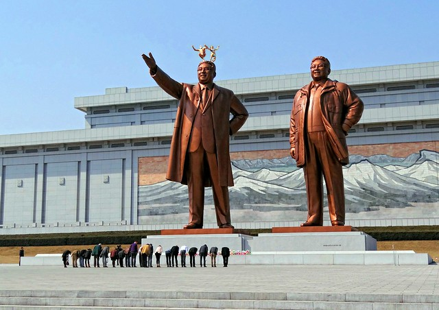 Much to Kim Jong-un's chagrin, Commaner Conrad and Felice Petite jump off the Mansu Hill Grand Monument in Pyongyang