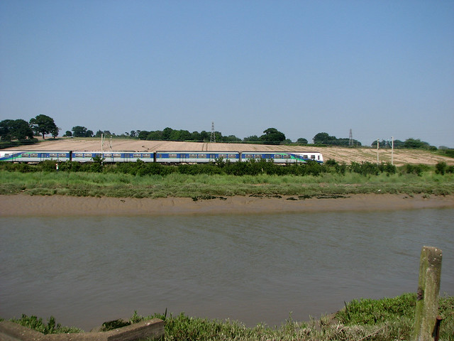A train beside the River Colne