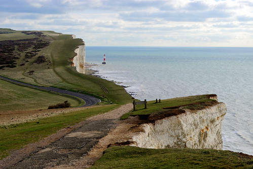 cliff chalk grass sea ocean sky lighthouse water road path 1000v40f ghe