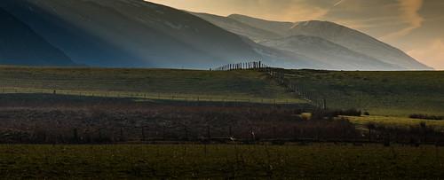lakedistrict rays sunlight earlylight morning winter countryside fence fenceline shaftsoflight hillside shadow
