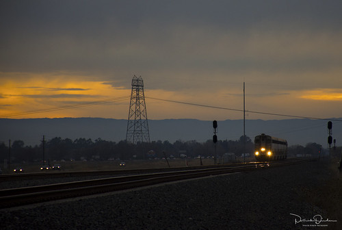 sunset dusk clouds yellow orange overcast rail railroad train passengertrain amtraktrain amtrak amtrakcalifornia capitolcorridor upmartinezsub davisca davis yolocounty sacramentovalley centralvalley northerncalifornia california