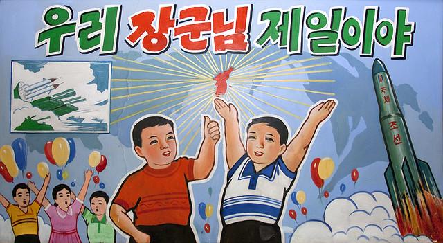 Propaganda poster depicting North Korean children celebrating a satellite launch, North Hamgyong Province, Chongjin, North Korea
