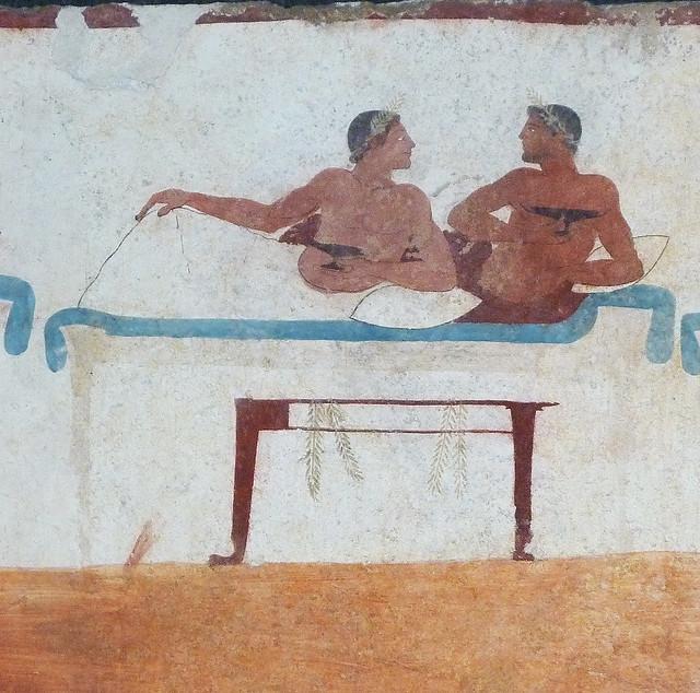 Symposium or Banquet scene: drinking men