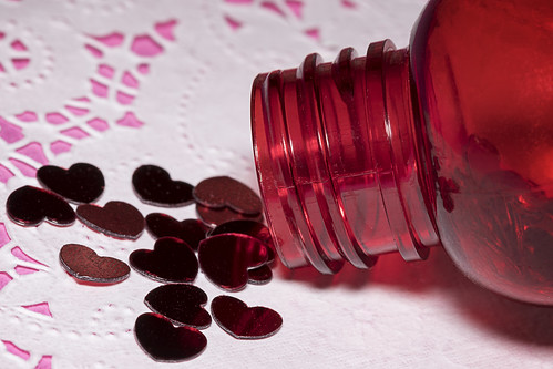 macromondays inabottle red heart valentine valentinesday love bottle hmm canoneos5dmarkiv ef100mmf28macrousm canon continuouslight dslr led neewer pink doily holiday decoration threads bottleneck narrow macro dof depthoffield fullframe closeupphotography macrophotography tabletopphotography photography shallowdepthoffield 100mm 5d4 focus manualfocus liveview tripod videolight props creative timer 10xfocus lovepotion pour spill nocap longexposure raw cameraraw shadow