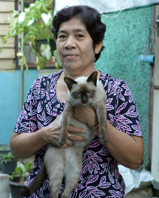 lady with her siamese cat
