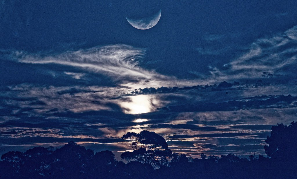 The sun sets, The moon rises
