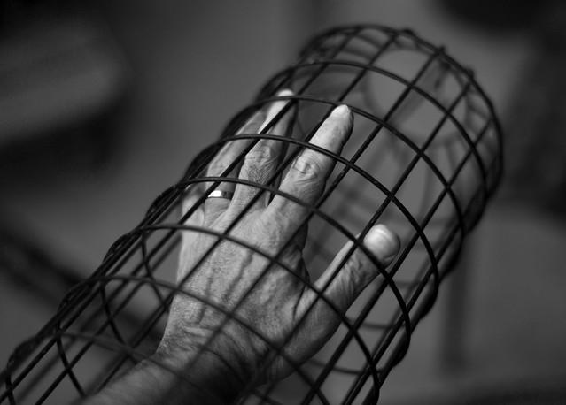 Caged hand
