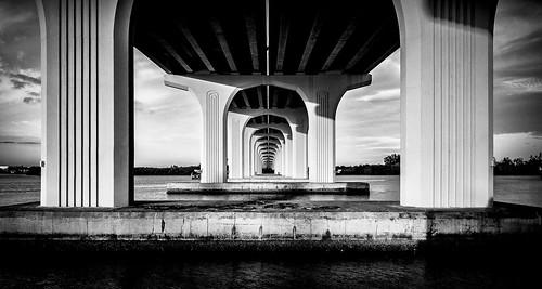 "7dwf ""pointofview"" perspective pov 2018 em1markii verobeach bridge infinity leadinglines blackandwhite landscape symmetry sky clouds morning shadows"