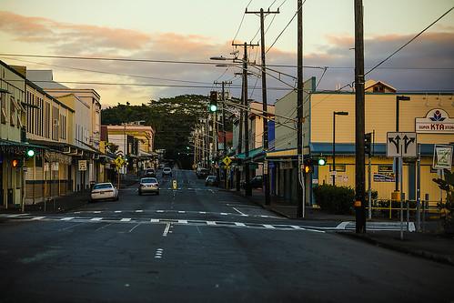 hawaii hilo bigisland keawest hi sunrise stores buildings streets tree clouds crosswalk stoplight powerpoles powerlines wyojones np