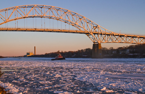 water ice sunset flow moving motion float floating winter cold arctic arcticblast weather freeze freezing frozen saltwater bay river canal stream current boat tug tugboat bridge light sunlight sunshine warmth
