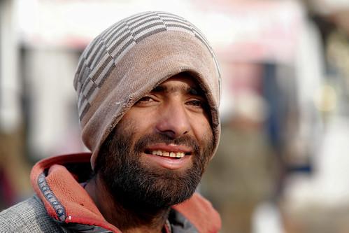 portrait face happy winter kashmir kashmiri gulmarg adventuresports travel india tourism sledgebearer people street samsungnx85mmf14edssalens