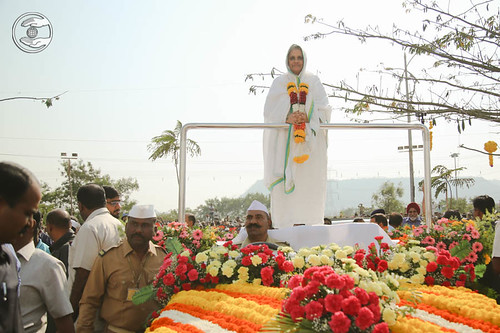 Satguru Mataji on flower bedecked open carriage