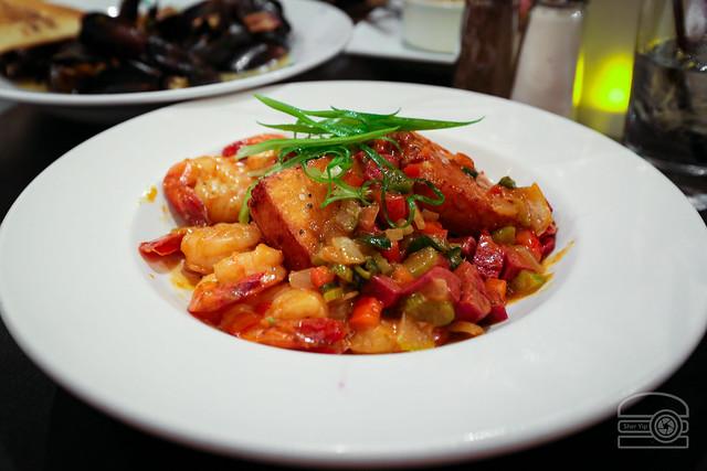 Shrimp & Grits Etouffee - Cajun Spiced Shrimp, Holy Trinity, Kielbasa, and Cheddar-Chive Grit Cakes - Iron Horse Tavern