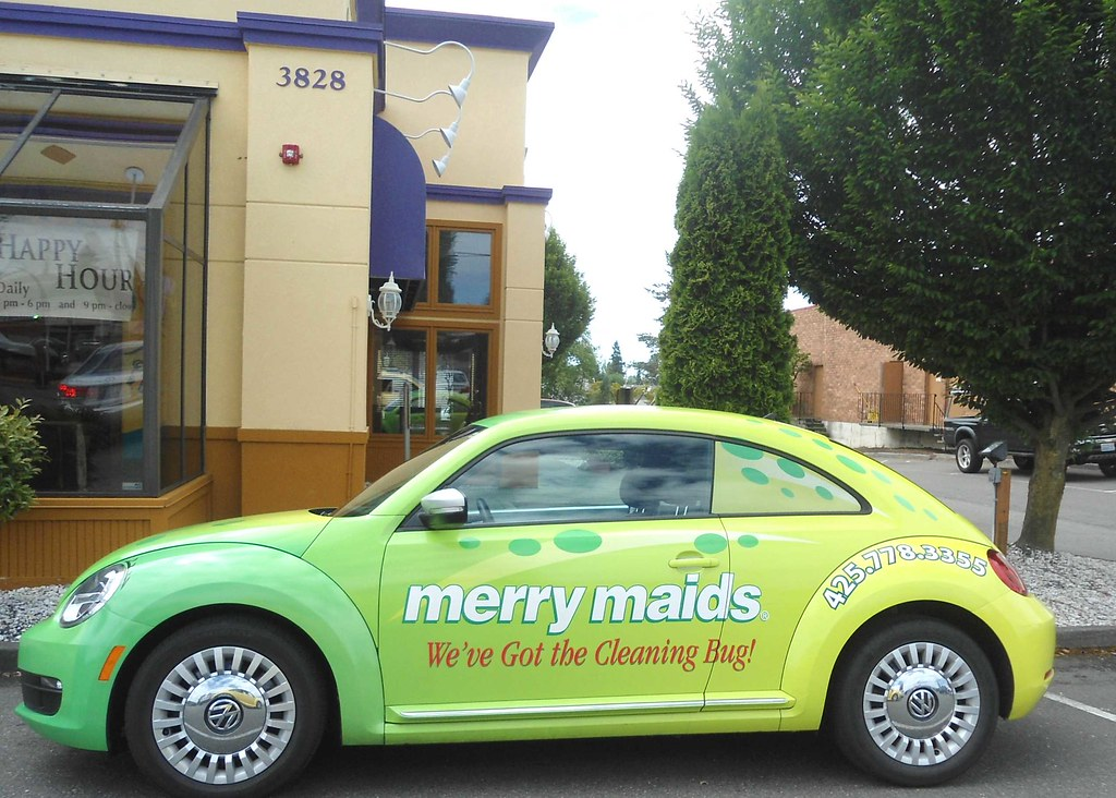 Volkswagen Beetle with Merry Maids Beetle Board ad wrap st