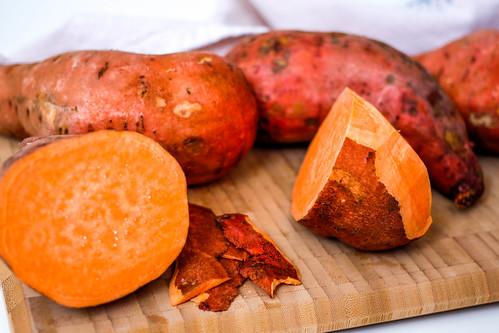 Sweet Potatoes on a Cutting Board   by wuestenigel