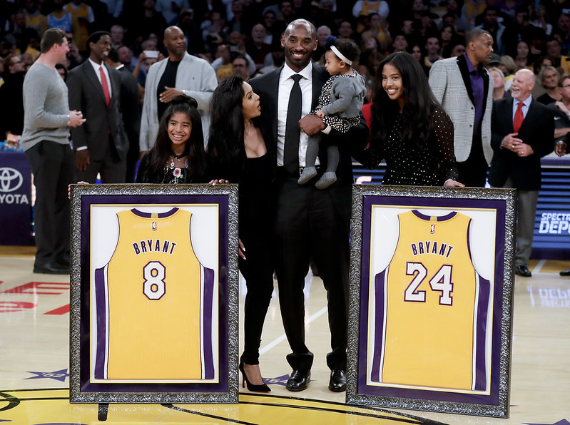 Kobe Bryant與家人合影。(達志影像資料照)