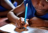 School child writing Sierra Leone