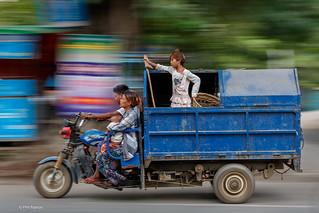 Garbage pickup family - Mandalay, Myanmar   by Phil Marion