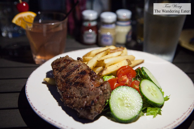Grilled strip steak with fries and salad