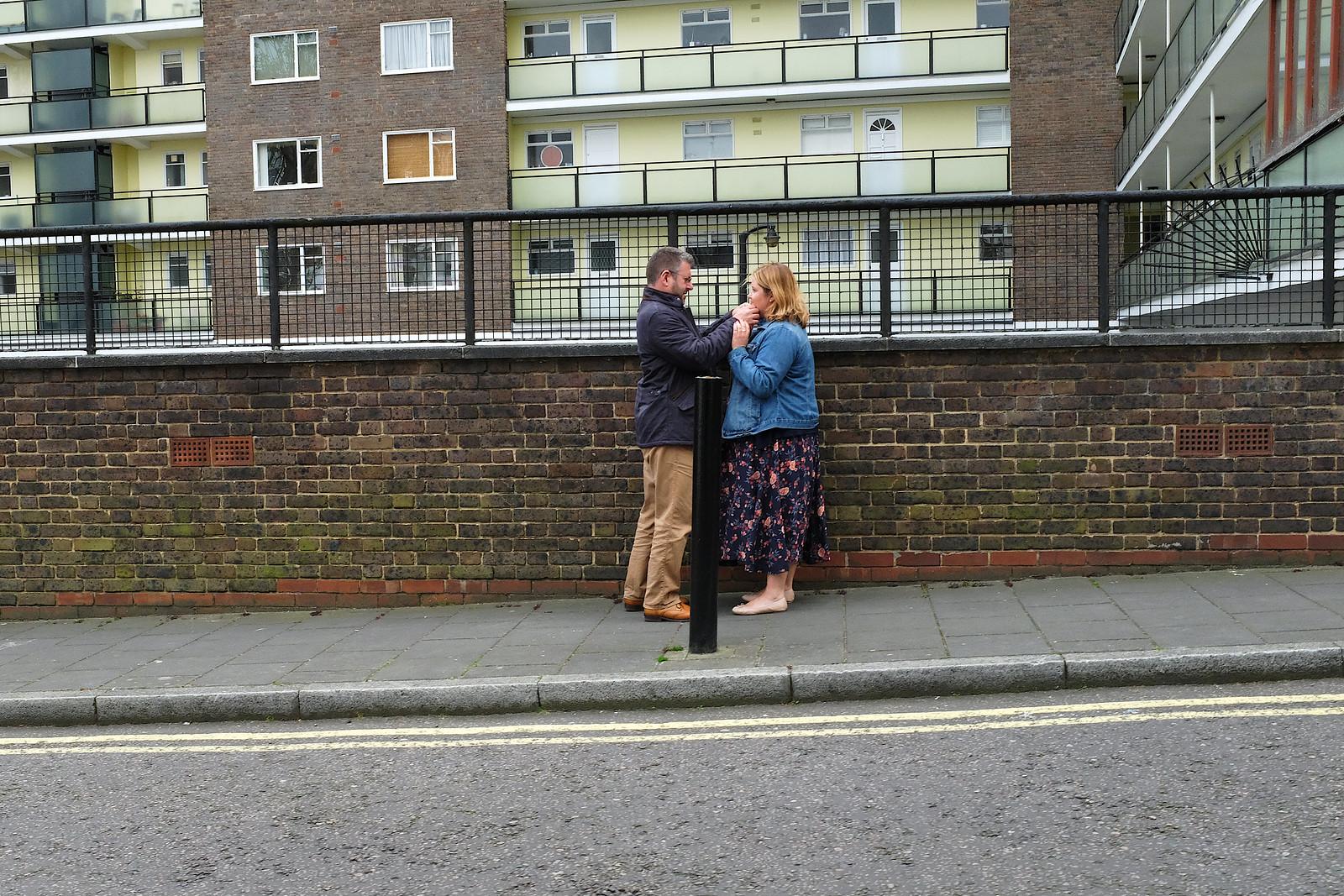 A man checks a woman's face