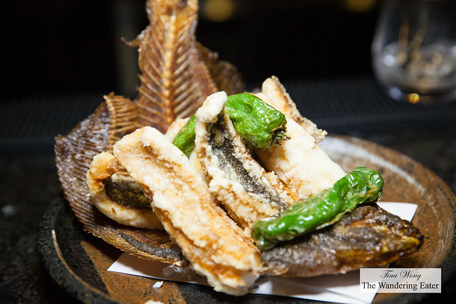 Whole fried flatfish with shisto peppers