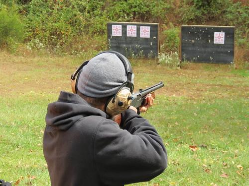 Photo of man target shooting