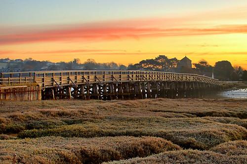 dawn sunrise sunset clouds river water inlet bridge wooden trees marsh swamp daybreak church