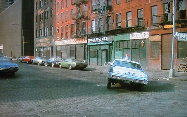 Last screenshot! Promise. In a scene from Kojak's first season, a police car careens in a high speed chase on cobblestoned streets in Lower Manhattan near what is now the South Street Seaport by the East River. Love that car's handling! New York. 1973.
