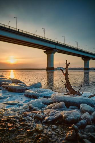 river ice bridge sun dawn bokeh sunset reflection winter cold