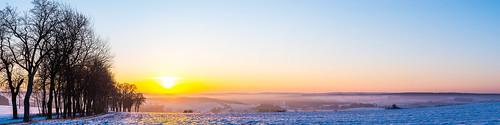 sunrise vogtland germany panorama panoramic landscape trees sun fields winter snow mist
