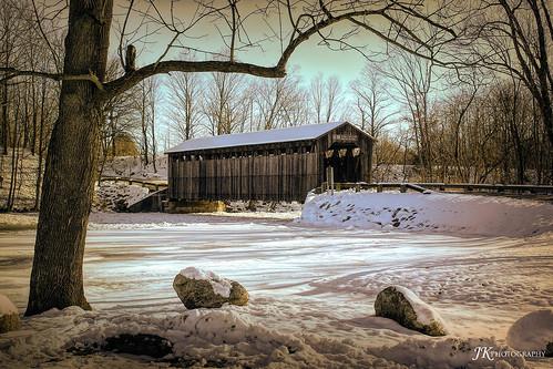 covered bridge fallesburgpark lowell michigan winter snow tree