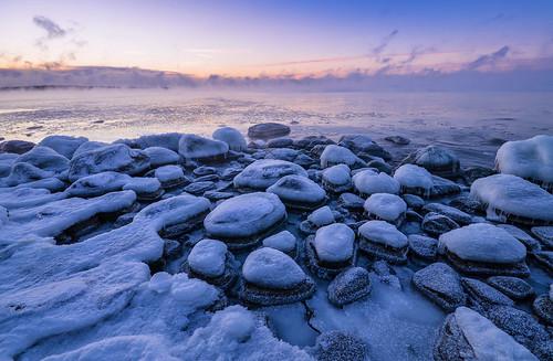 winter rocks sea seashore seascape morning mist seasmoke ice icy snow freezing frost frozen lauttasaari helsinki finland