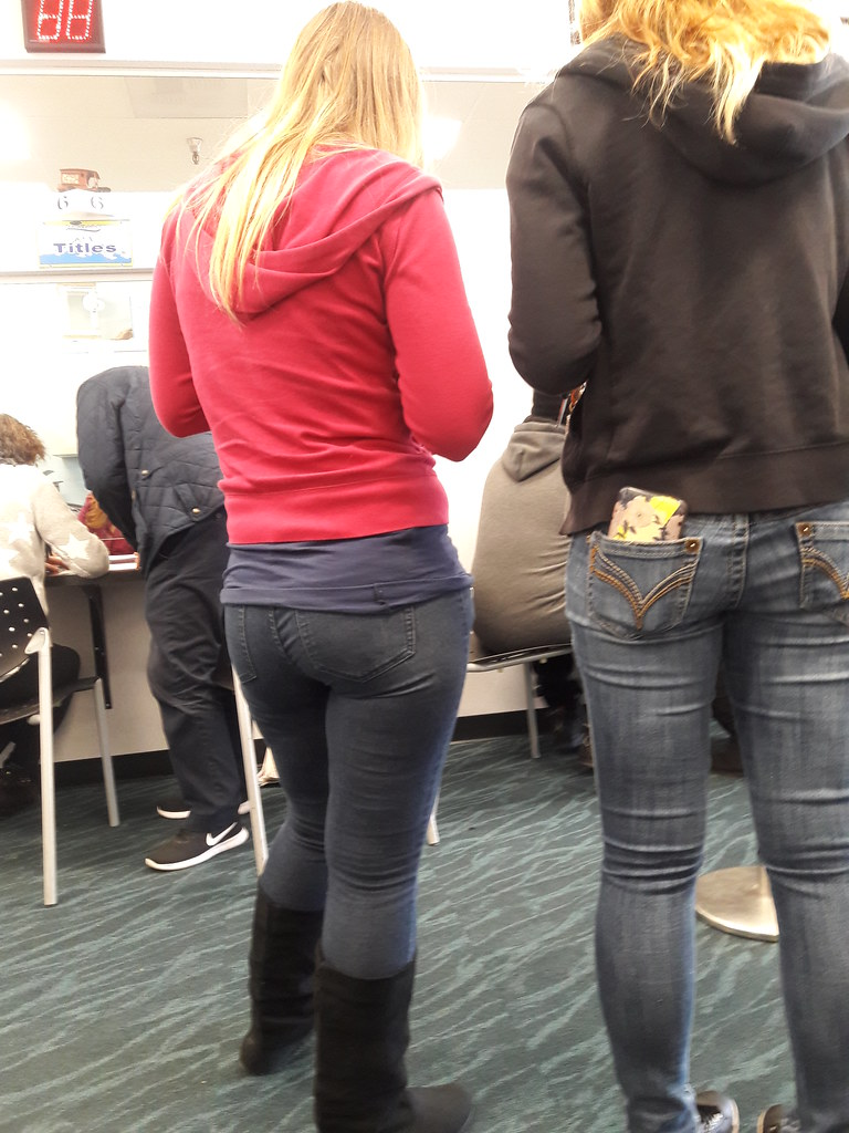 blond women waiting in line for a vehicle title  red and b