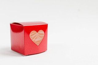 Red square gift box with a heart   by wuestenigel