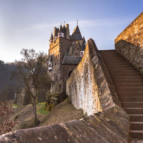 castle eltz rheinlandpfalz germany sunrise sun stairs outdoor outdoors architecture medieval stone tree sky morning nature castleeltz burgeltz moselkern mosel redfurwolf sonyalpha sony a99ii sal2470f28za sonydeutschland travel