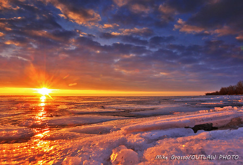 lakeeriemetropark landscapephotography lakeerie michiganoutdoors scenics sunrise greatlakestate sun sky clouds ice snow waterwinterwonderland canonphotography canonlenses canon6d