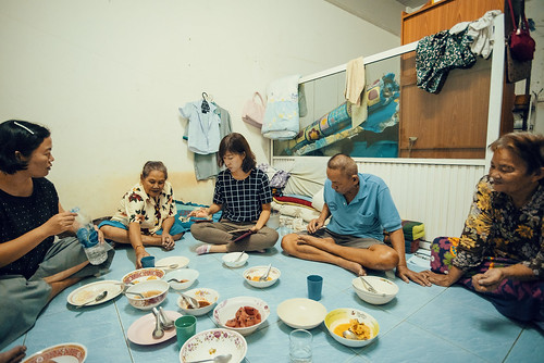 Sunny helps lead a small Bible study group in one of the low-income housing complexes in Bangkok's South-East. Sharing a meal is an important part of all such gatherings.
