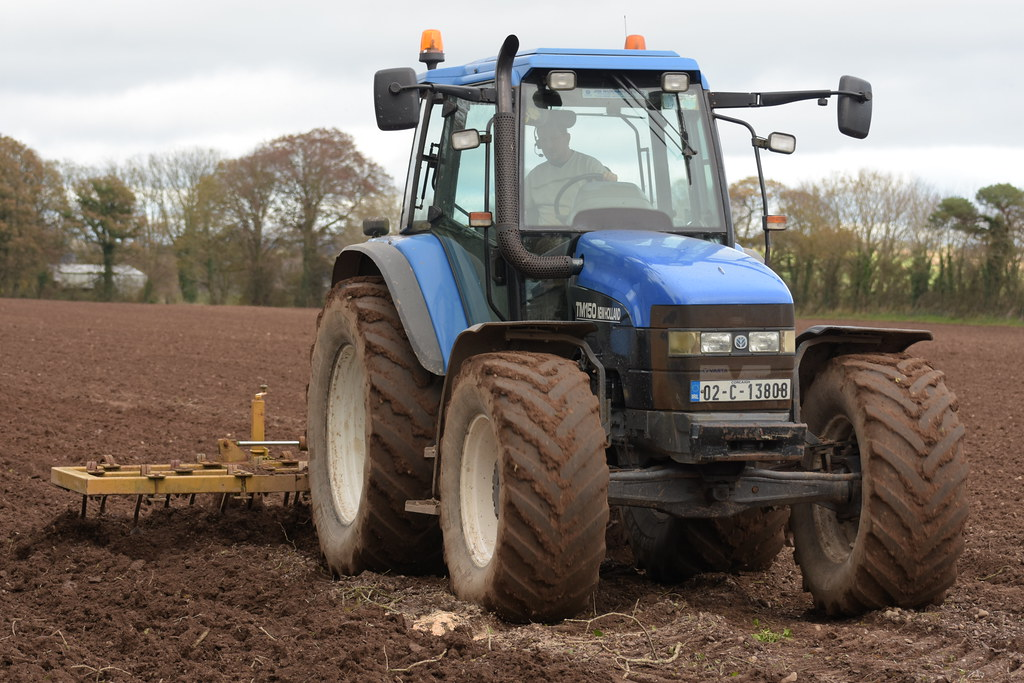 New Holland TM150 Tractor with a Spring Tine Cultivator | Flickr
