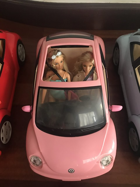 To save up space I am placing dolls inside my Barbie cars.