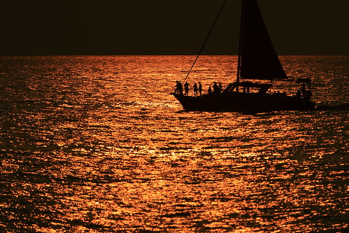 sailboat sailing sail copper water sunset sea ocean reflection boat watercraft evening sun ship outdoor transportation vessel large calm yacht horizon silhouette dawn background nature outdoors dusk sunrise night lake floating travel coast recreation harbor port
