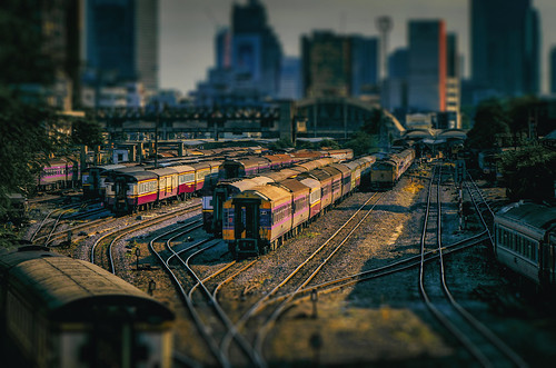 coaches carriages passengercars railroadyard tracks switches sidings rollingstock locomotives emptytrains waitingtrains bangkokrailwaystation สถานีรถไฟกรุงเทพ srt staterailwayofthailand bangkokthailand city urban downtown hualamphongstation สถานีหัวลำโพง pathumwandistrict cityscape tiltshift toytrains buildings architecture skyline skyscrapers highrises goldenhour landscape thai asian siam southeastasia transportation nikond5100 tamron18270 photoshopbyfehlfarben thanksbinexo