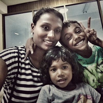Genine at home with her two kids, Samuel and Daniele - Photo courtesy of Genine Thomas.