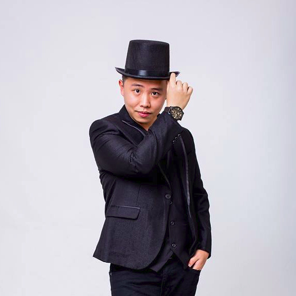 Chris Cheong In Back Suit Potrait