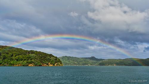 aucklandregion greatbarrierisland nz newzealand northisland clouds rain rainbow sailing storm haurakigulf portfitzroy kaiararabay water